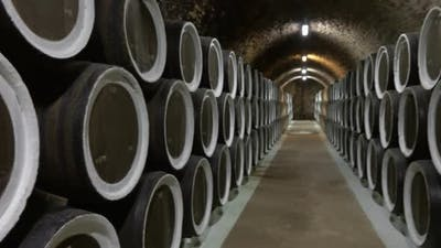 Barrel Filled with Wine in Wine Cellar