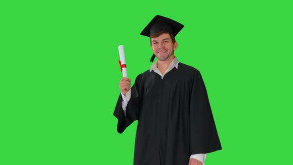Thumbnail for Happy Male Student in Graduation Robe Waiving with His Diploma on a Green Screen Chroma Key