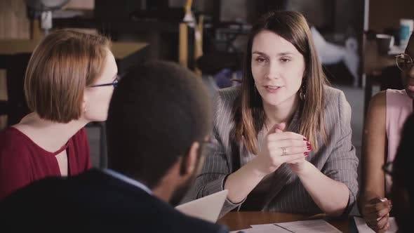 Thumbnail for Happy Successful Businesswoman Talking To Multiethnic Colleagues at Corporate Board Meeting