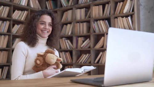 Hispanic Woman Teacher Read Children Book Look at Laptop Online Kindergarten
