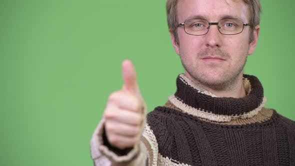 Thumbnail for Studio Shot of Happy Handsome Man Giving Thumbs Up