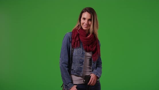 Cover Image for Portrait of smiling millennial girl standing on green screen