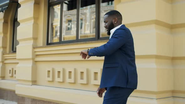 Young Businessman Running in Hurry