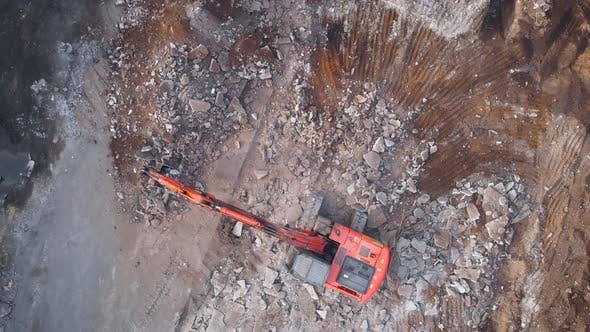 View From Above. A Large Excavator Dismantles the Concrete Base.