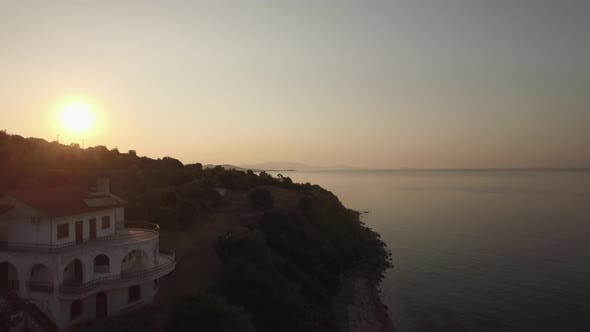 Thumbnail for Aerial View of Sea, Waterfront Road and Upland Landscape at Sunset, Greece