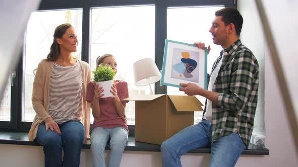 Cover Image for Happy Family with Child Moving To New Home