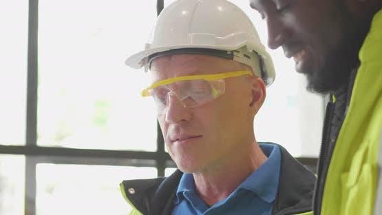 Diverse team senior industry engineer discuss