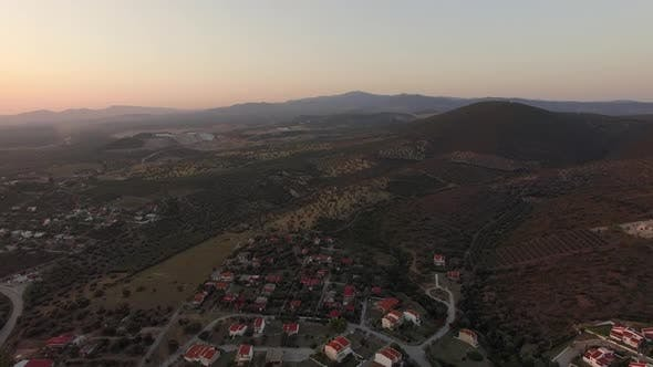 Thumbnail for Aerial Scene of Cottages, Green Landscape with Hills and Plains in Greece