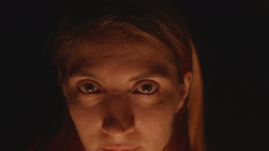 Woman Eyes In Darkness And Candle Light