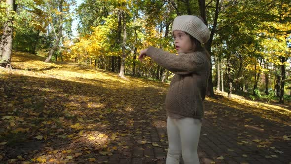 Cover Image for Adorable Girl with Down Syndrome Dancing in Nature