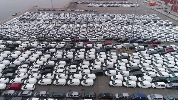 Thumbnail for Aerial View of Lot New Unsold Cars on Pier