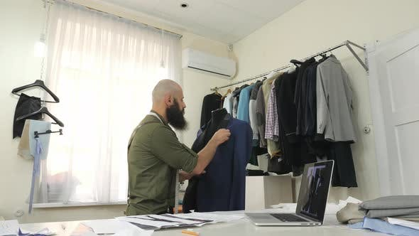Tailor draping a jacket