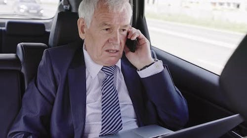 Politician with Phone in Car