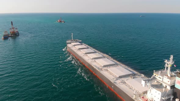 The Bulk Carrier Left the Port and Moves in the Right Direction at High Speed.