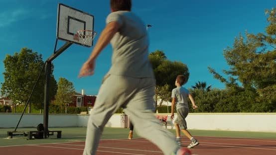 Son Playing Passing Basketball with Father and Mother