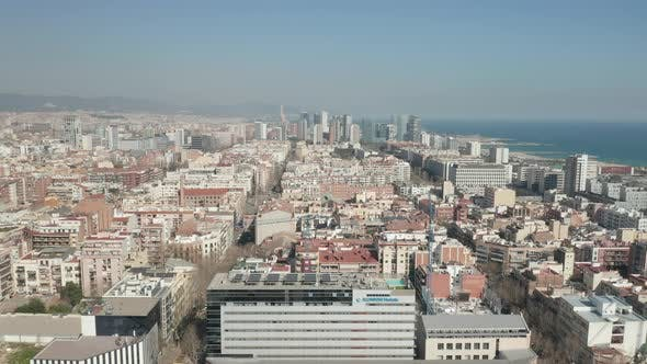 Thumbnail for Barcelona Wide Drone Shot of City Towards Skyline Cityscape