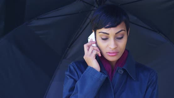 Thumbnail for African woman stuck in rain storm trying to make phone call