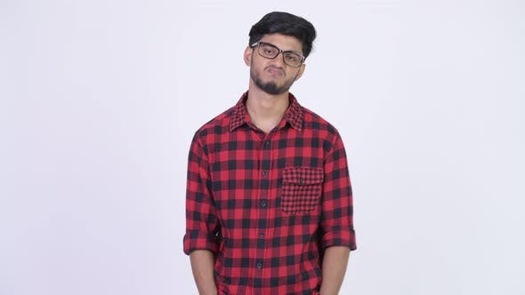 Thumbnail for Young Stressed Bearded Indian Hipster Man Looking Bored