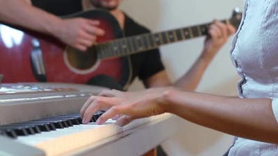 Guitarist And Pianist Playing