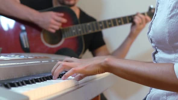 Thumbnail for Guitarist And Pianist Playing