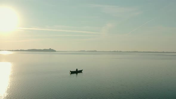 Thumbnail for Aerial Drone View of Fisherman on the Boat on the Sunrise, Morning Fishing, Swimming on a Calm Lake