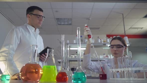 Thumbnail for Two Scientists Man and Woman in Lab.