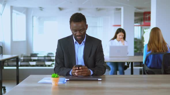 Thumbnail for Handsome Man Office Employee Using Smartphone Texting Message at Workplace