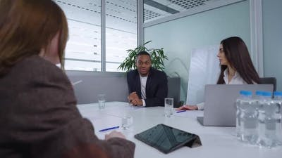 Business People Brainstorming at Meeting