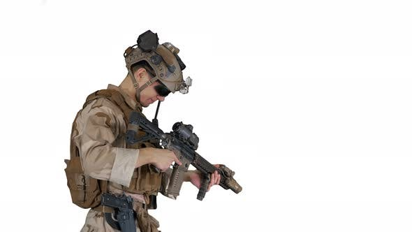 Soldier Changing Clip with Bullets on Automatic Rifle While Walking on White Background
