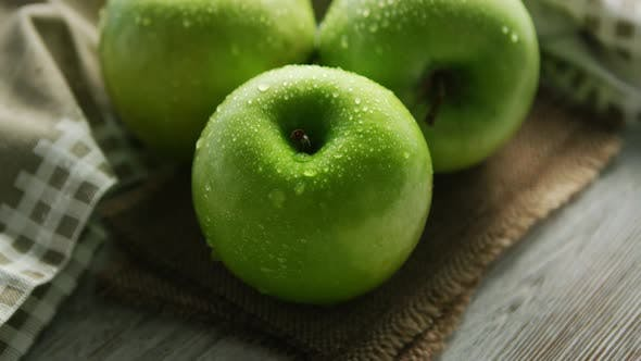 Green Apples in Water Drops