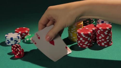 Lucky Poker Player Showing Good Cards to Rivals, Winner in Casino Tournament