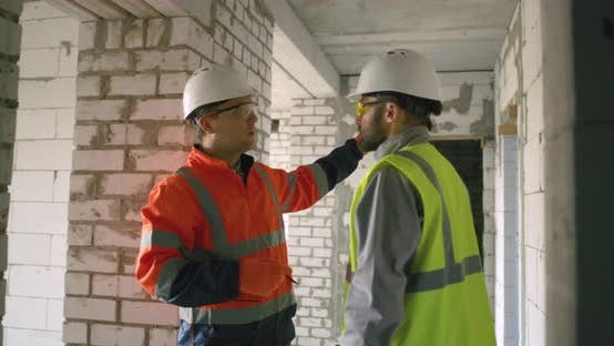 Thumbnail for Contractors Discussing Ceiling of Unfinished Building