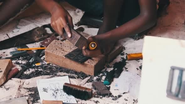Local African Makes HandMade Souvenirs at the Tourist Market Zanzibar Africa
