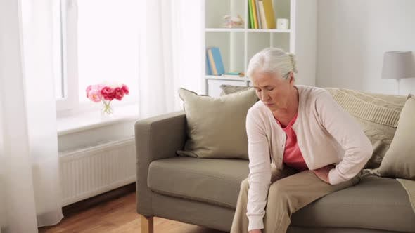 Cover Image for Senior Woman Suffering From Pain in Leg at Home