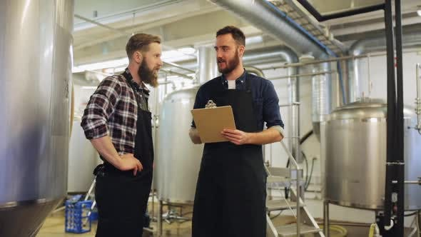 Brewers with Clipboard at Brewery or Beer Plant