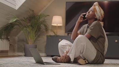 Young Black Woman Having Phone Conversation