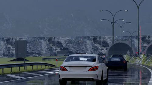 Vehicles Moving Towards the Tunnel in Rainy Weather