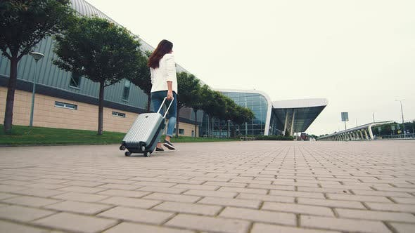Woman Walking with Luggage. The Girl Goes on a Journey and Walks To the Airport. A Businesswoman