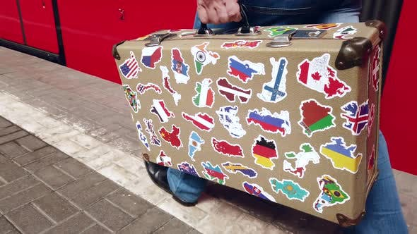Thumbnail for Passenger Is on the Platform of the Station with a Suitcase with Stickers From Different Countries
