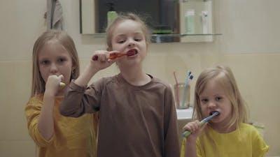 Children Brush Their Teeth