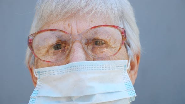 Thumbnail for Portrait of Granny in Glasses Wears Protective Mask From Virus. Grandma Looks Into Camera with