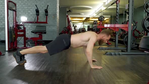 Thumbnail for Athlete with Toned Body Doing a Jump Pushup in an Indoor Gym