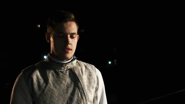 Portrait Of Young Fencer Man Looking Into Camera On The Street.