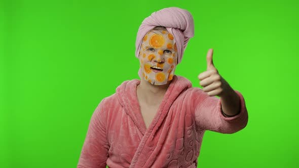 Thumbnail for Transsexual Man in Bathrobe with Face Mask Giving Thumbs Up. Chroma Key