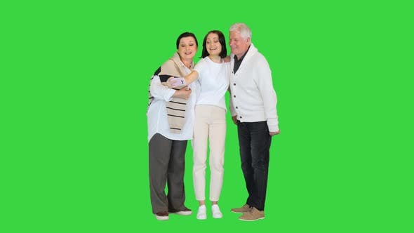 Grand Dad, Mother and Daughter Taking a Selfie on a Green Screen, Chroma Key