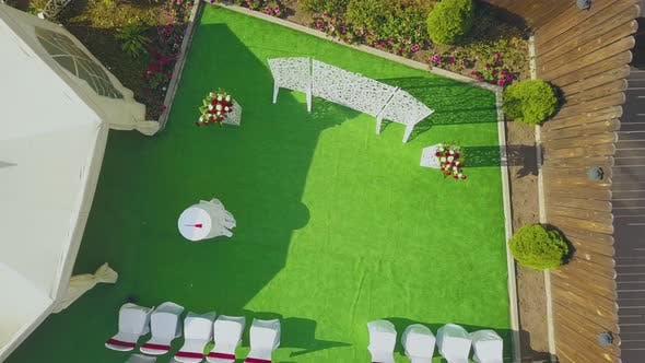 Wedding Venue with Flowers Near Tent in Yard Aerial View