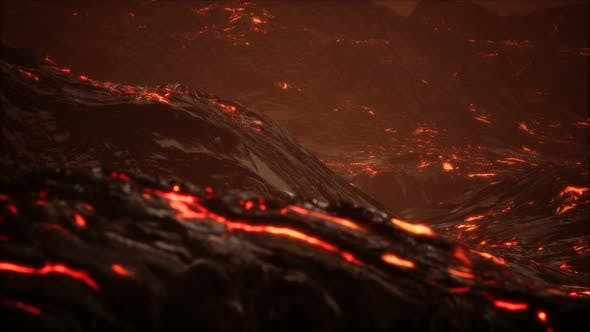 Thumbnail for Red Orange Vibrant Molten Lava Flowing Onto Grey Lavafield and Glossy Rocky Land