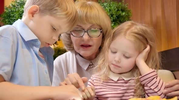 Thumbnail for Kids Playing on Tablet with Grandmother