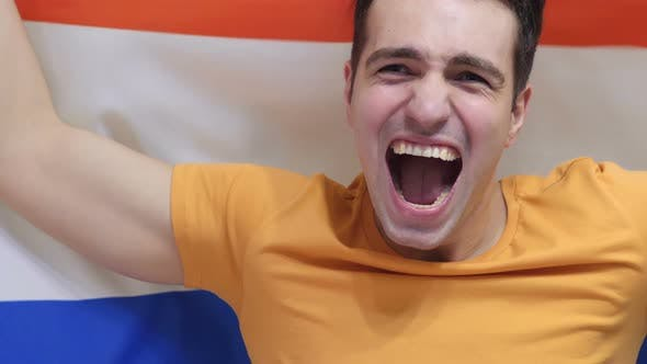 Thumbnail for Netherlands Young Man celebrates Holding the Flag of Netherlands