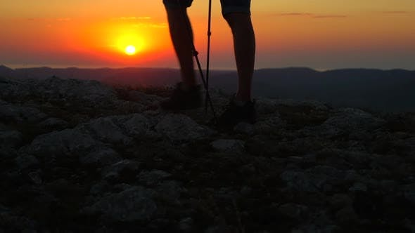Thumbnail for Closeup View of Man Walking Over Rocks During Sunset in Amazing Natural Area Spbd.